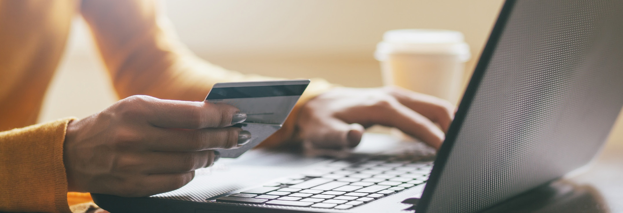 Photo of female using credit card to make a purchase online